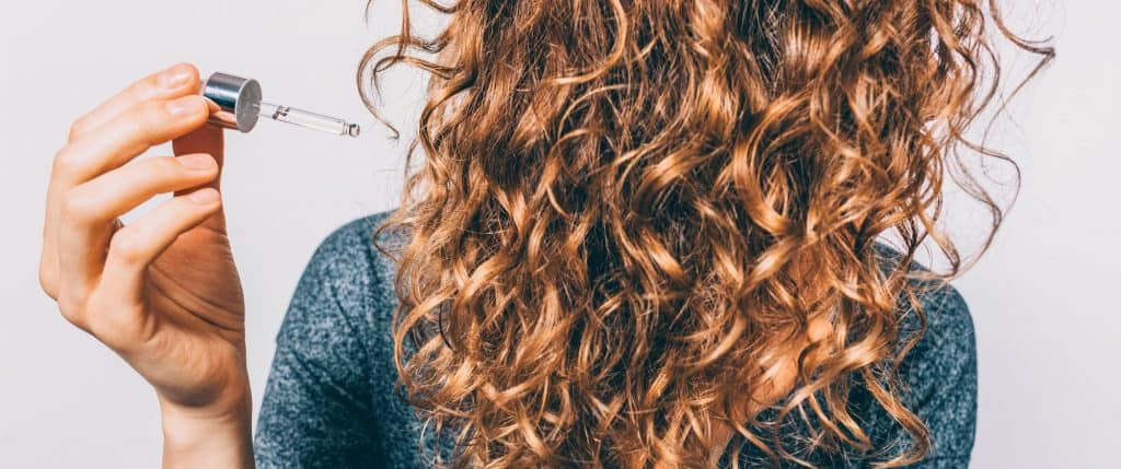 serum containing silicones for curly hair
